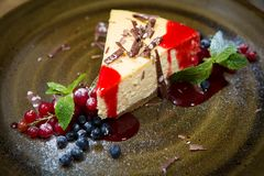 Cheesecake with strawberry sauce Stock Photos