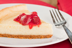 Cheesecake with strawberry topping Stock Images