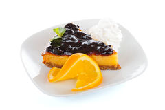 Cheesecake. Tasty cheesecake with blueberry jam topping Royalty Free Stock Images
