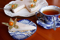 Cheesecake and tee in Russian traditional painted porcelain cup in gzhel Stock Image