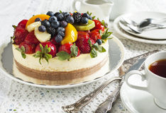 Cheesecake topped with berries and fruits Stock Images