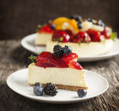 Cheesecake topped with berries and fruits Royalty Free Stock Image