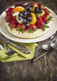 Cheesecake topped with berries and fruits Royalty Free Stock Images