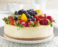 Cheesecake topped with berries and fruits Stock Photos