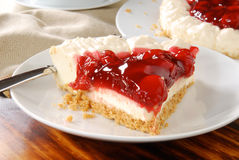 Cheesecake topped with cherries Royalty Free Stock Images