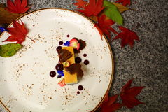 Cheesecake. With white chocolate, blackberry coulis, chocolate crunch. Perfect proposition for cold autumn evening Stock Photo
