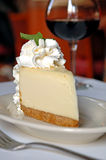 Cheesecake and wine Royalty Free Stock Images