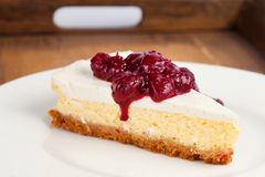 Cheesecake on a wooden tray Royalty Free Stock Photo