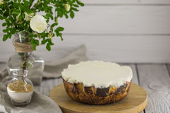 Cheesecake on wooden tray,  a beautiful background. Cheesecake on wooden tray, on a beautiful background with a bouquet of flowers Stock Photo