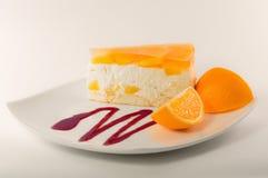 Cheesecake z pomarańcze galaretą obrazy stock