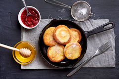 Cheesecakes, curd cheese pancakes. In cast iron frying pan, top view Royalty Free Stock Images