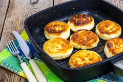 Cheesecakes fried on a grill pan Royalty Free Stock Photo