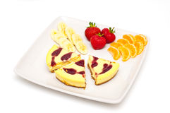 Cheesecakes and fruit Royalty Free Stock Photos