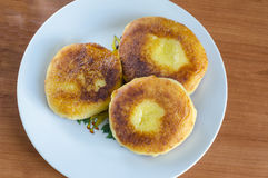 Cheesecakes. Grandma's curd pancakes with their hands on the country Royalty Free Stock Image