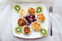 Cheesecakes with kiwi and cranberries Stock Photo