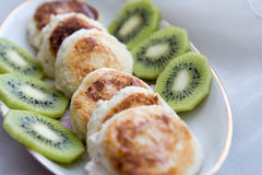 Cheesecakes with kiwi slices Stock Image