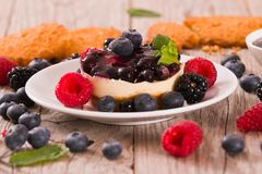 Cheesecakes with mixed berries. Cheesecakes with mixed berries on white dish stock photo