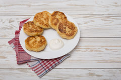 Cheesecakes with sour cream for breakfast Stock Images