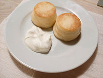 Cheesecakes with sour cream. Stock Image