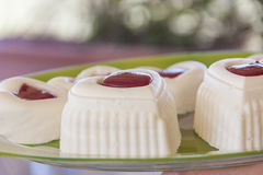 Cheesecakes. White cheesecakes with red jelly Stock Photos