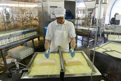 Cheesemaker preparing the cheese in a show dairy at Engelberg Stock Images