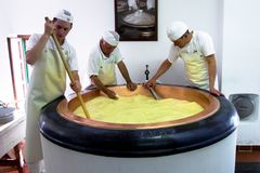 Free Cheesemakers At Work Royalty Free Stock Photography - 123476977