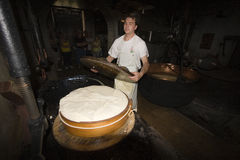 A cheesemonger in a ancient dairy, Franche-Comté, France Royalty Free Stock Images