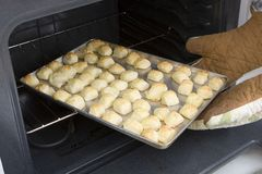Cheesepuffs baking in oven (Recipe series) Stock Photography