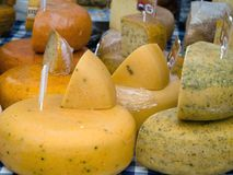 Cheeses. Produce at farmers market Stock Photo