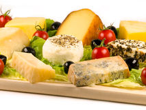 Cheeses. Varieties of different cheeses with vegetables stock photos