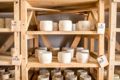 Cheeses aging at the cellar Stock Photo