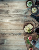 Cheeses And Brown Bread On Wooden Table Stock Photography
