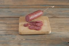 Cheeses And Sausage On Wooden Aged Background. Stock Images