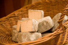 Cheeses in basket stock photos