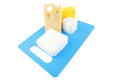 Cheeses on blue plate Royalty Free Stock Photo