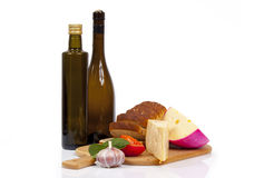 Cheeses and bread Stock Images