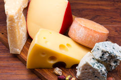 Cheeses on cheese board Stock Photos