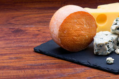 Cheeses on cheese board Stock Image