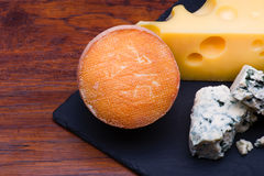Cheeses on cheese board Stock Photography