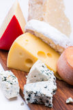 Cheeses on chopping board Royalty Free Stock Photography