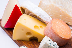 Cheeses on chopping board Stock Photography