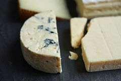 Cheeses chops on black background Royalty Free Stock Images