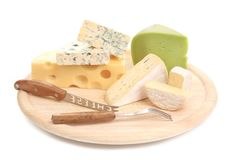 Cheeses on cutting board. Stock Photo