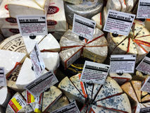 Cheeses on display being sold at a Supermarket Royalty Free Stock Image