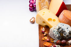 Cheeses with dried fruits and nuts Royalty Free Stock Photos