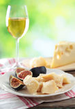 Cheeses, figs, and wine Royalty Free Stock Photo
