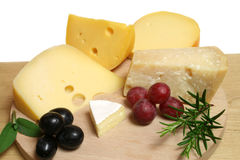 Cheeses and grapes Royalty Free Stock Photography