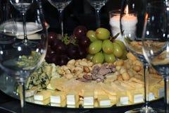 Cheeses grapes delicacies Stock Photo