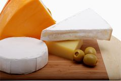 Cheeses on grocery board Royalty Free Stock Image