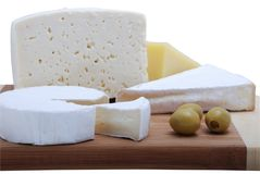 Cheeses on grocery board Stock Images